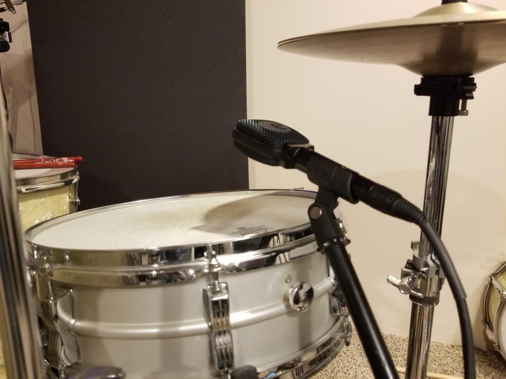 Sennheiser e906 mic on snare drum