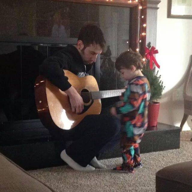 Here's me playing my acoustic guitar with my kiddo.
